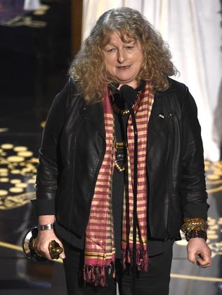 "Jenny Beavan accepts the award for best costume design for ""Mad Max: Fury Road""."