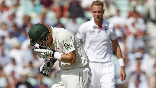 Shane Watson reacts after getting hit in the head by a bouncer from England's Stuart Broad.