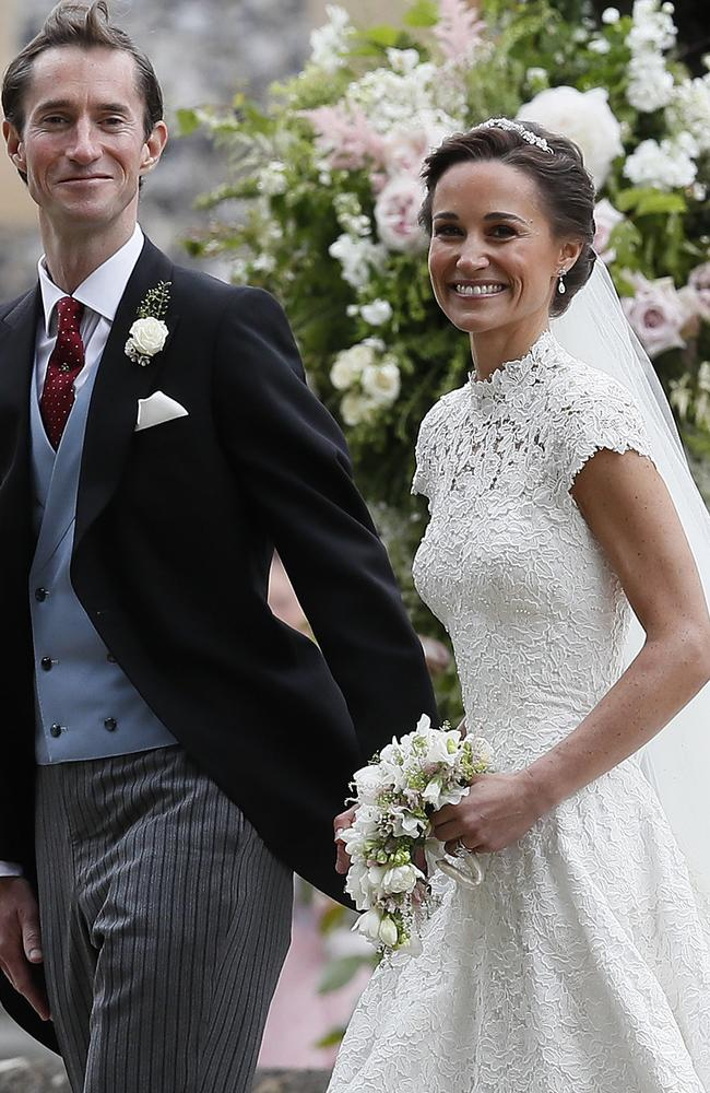 Pippa, with new husband James Matthews after the ceremony, wore her hair in a classic up-do with a diamond headband. Picture: AP Photo/Kirsty Wigglesworth, Pool