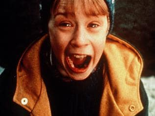 """Actor Macaulay Culkin in scene from film """"Home Alone"""". /Films/Titles/Home/Alone"""
