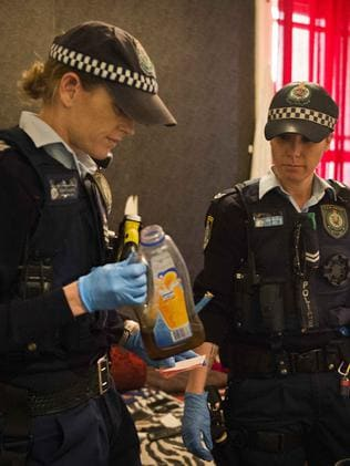 Police hold a bong' in a room in the Astoria Hotel. Picture: Chris McKeen