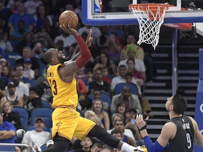 Cleveland Cavaliers forward LeBron James drives to the basket in a game against the Orlando Magic.