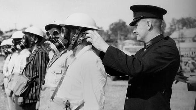 Men get their gas masks checked at Auchenflower in 1942. Picture: State Library