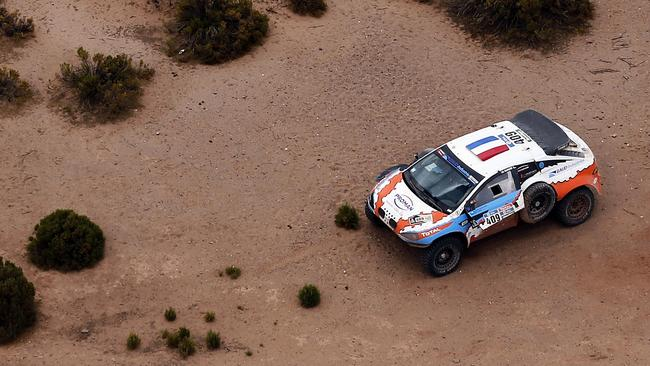 The Mitsubishi of Lionel Baud of France is seen on the side of the road during the Stage 7 of the Dakar Rally 2016. A 63 year-old Bolivian spectator died after he was ran over by Baud, Dakar officials informed.