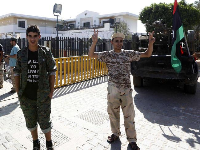 Members of the Fajr Libya Islamist militia gather at the US diplomatic compound in Tripoli.