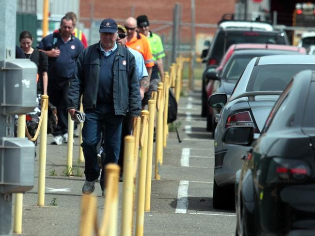 Tough times ... workers leave the Holden plant in Elizabeth, SA, in 2012 after being told that 170 voluntary redundancies were being offered.