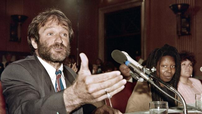 A file picture taken on May 9, 1990 in Washington, shows US actor Robin Williams (L) speaking at a Senate committee hearing on the Homelessness Prevention and Revitalization Act of 1990, next to US actress Whoopi Goldberg (R).