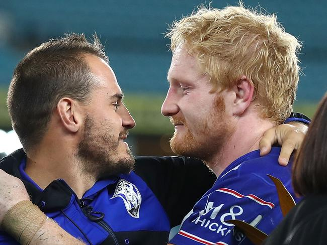 SYDNEY, AUSTRALIA - AUGUST 20:  Departing Bulldogs player Josh Reynolds embraces James Graham of the Bulldogs on stage after a presentation to the players and officials leaving the club at the end of the season after the round 24 NRL match between the Canterbury Bulldogs and the Manly Sea Eagles at ANZ Stadium on August 20, 2017 in Sydney, Australia.  (Photo by Mark Kolbe/Getty Images)