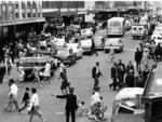 Christmas shoppers mingle with the heavy motor traffic on Rundle St, December 22, 1964.