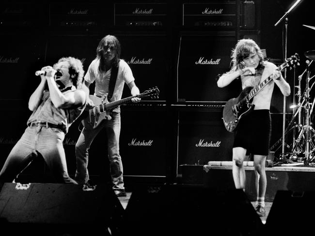 Brian Johnson performing next to guitarists Malcolm Young and Angus Young of Australian legendary hard rock band AC/DC at the Palais Omnisport of Paris Bercy, on September 15, 1984 in Paris. Picture: AFP