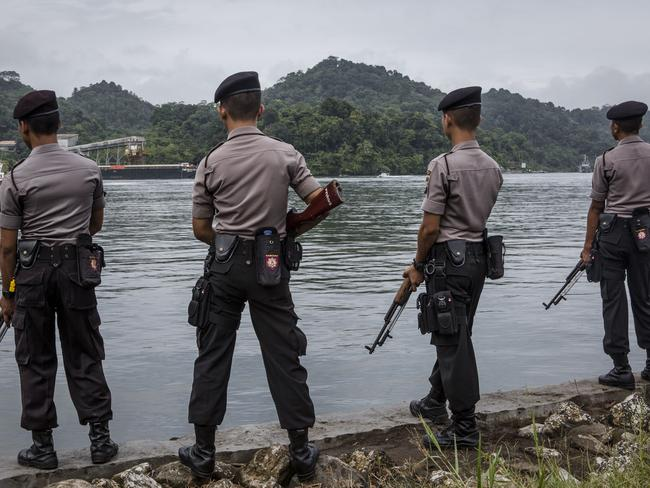 Keeping watch ... Indonesian police stand guard as the Bali Nine duo Andrew Chan and Myuran Sukumaran arrive at Wijaya Pura Port before they were transferred to Nusa Kambangan prison. Picture: Ulet Ifansasti/Getty Images