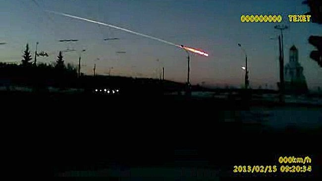 In this frame grab made from dashboard camera video, a meteor streaks through the sky over Chelyabinsk, about 1500km east of Moscow, Friday, Feb. 15, 2013. With a blinding flash and a booming shock wave, the meteor blazed across the western Siberian sky Friday and exploded with the force of 20 atomic bombs, injuring more than 1,000 people as it blasted out windows and spread panic in a city of 1 million. (AP Photo/AP Video)