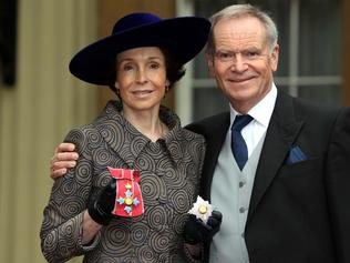 Mary Archer poses after she was made a Dame with her husband Jeffrey Archer in 2012.