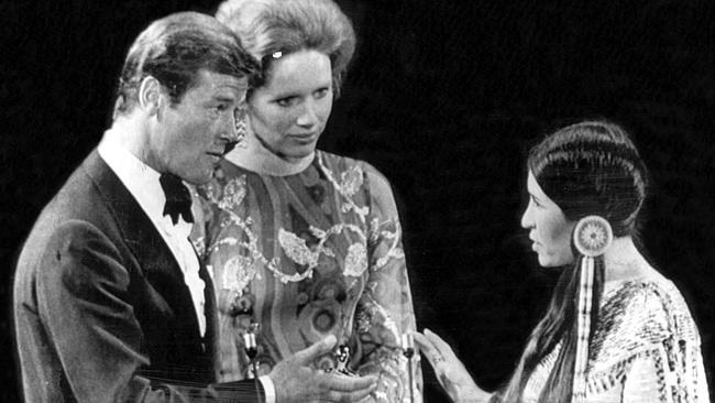 Rejected ... Sacheen Littlefeather (right) refused to accept the Oscar on behalf of Marlon Brando because of the treatment of Native Americans, to the shock of Liv Ullmann and Roger Moore.