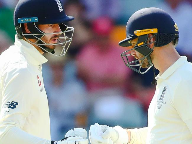 England's Mark Stoneman (R) congratulates teammate James Vince (R) on his half century on the first day of the first cricket Ashes Test between England and Australia in Brisbane on November 23, 2017. / AFP PHOTO / Patrick HAMILTON / --IMAGE RESTRICTED TO EDITORIAL USE - STRICTLY NO COMMERCIAL USE--