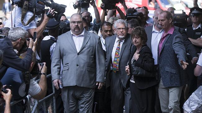 Hounded by the press ... Rolf Harris arrives at Southwark Crown Court. Picture: Oli Scarff