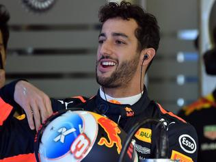 Red Bull's Australian driver Daniel Ricciardo gets ready to ride during the first practice session for the Formula One Australian Grand Prix in Melbourne on March 24, 2017. / AFP PHOTO / SAEED KHAN / -- IMAGE RESTRICTED TO EDITORIAL USE - STRICTLY NO COMMERCIAL USE --