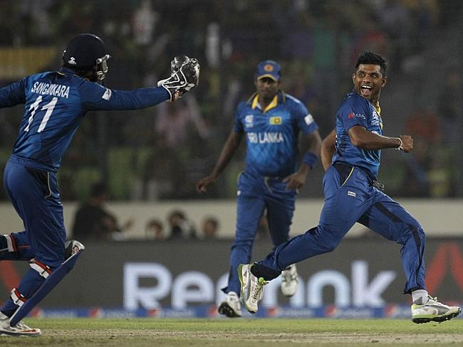 Sri Lanka's Seekkuge Prasanna, right, celebrates a West Indies wicket.