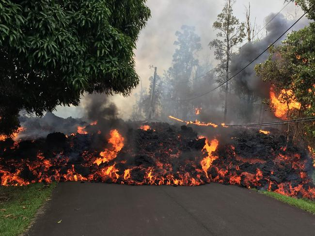 This image released by the US Geological Survey shows a lava flow moving on Makamae Street in Leilani Estates on May 6, 2018. Picture: AFP