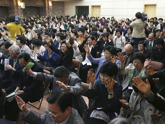 Many bodies still to be found ... Christians pray during a service for the safe return of passengers of the sunken Sewol ferry at a church in Seoul, South Korea.