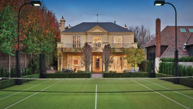34 Kooyongkoot Rd, Hawthorn. A floodlit tennis court to the rear will help keep you in shape.