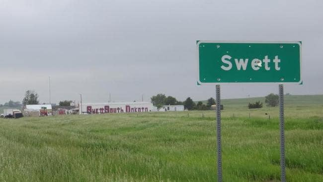 The sign leading into the town of Swett comes it is own bullet holes. Pictures: Zillow.