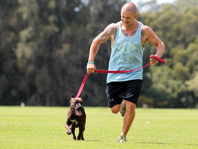 Jason Siebert enjoying a run with foster dog 'Sonny' who he found at Gosford Dog Paws.