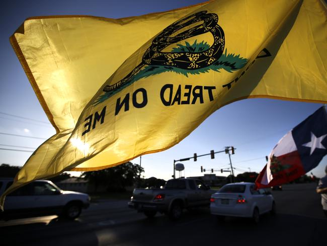 Revolutionary slogan ... Gun rights activists wave a 'Don't Tread on Me' flag at a demonstration in Texas. Picture: AP