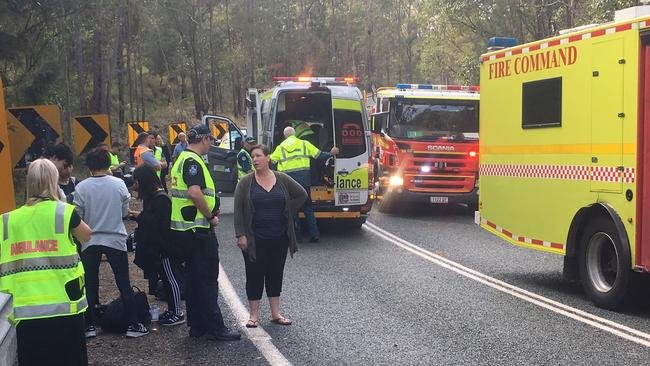 Emergency services speak to people at the scene. Picture: Greg Stolz