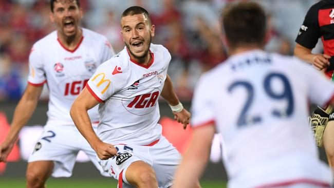 Apostolos Stamatelopoulos celebrates after he scored the equaliser for Adelaide United.