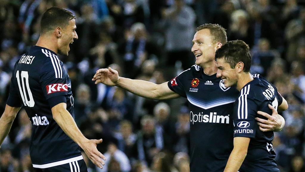 Melbourne Victory's Marco Rojas celebrates his goal with James Troisi and Besart Berisha.