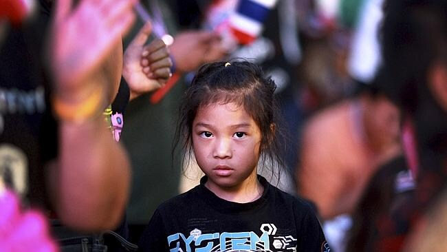 A Thai girl joins her family in an anti-government protest outside Parliament.