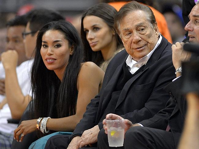 Los Angeles Clippers owner Donald Sterling, right, and V. Stiviano, left, watch the Clippers.