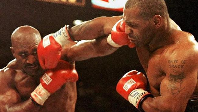 Tyson (right) in the 1997 fight in which he bit off opponent Evander Holyfield's ear. Picture: Supplied.