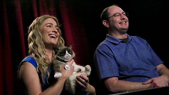 Tabatha Bundesen (left) is Grumpy Cat's owner. Here she, and her brother Bryan Bundesen, smile during a TV interview. One of many media appearances since Bryan put images of Grumpy Cat on Reddit.