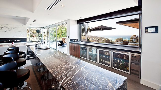 The kitchen is almost as stunning as the view in this Eagle Bay dream holiday house.