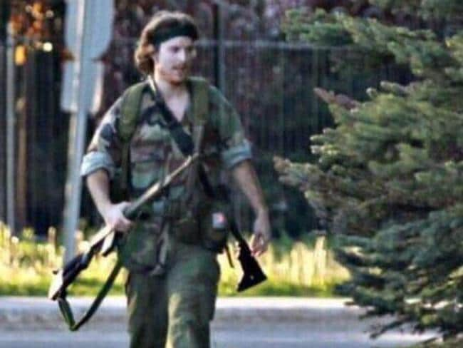 Shot two police officers ... 24-year-old Justin Bourque is pictured after the shootings with two high-powered rifles. Picture: Moncton Times and Transcript / Twitter