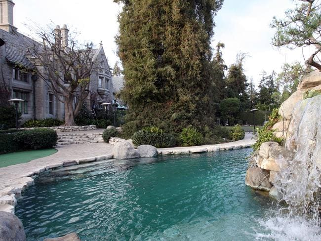 The mansion comes with a swimming pool and waterfall.