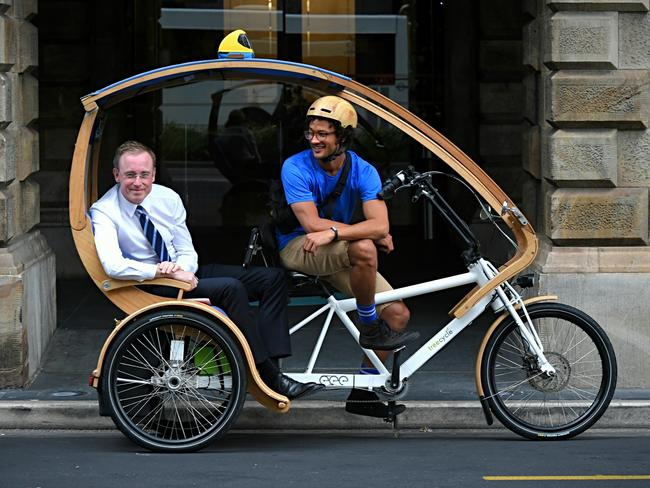 Adelaide Lord Mayor Martin Haese getting into an eco caddy (green taxi) for a ride around the city. Picture: Roy VanDerVegt
