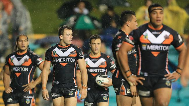 Dejected Tigers players have they concede another try against the Roosters.