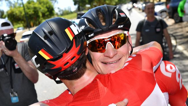 German cyclist Andre Greipel of team Lotto-Soudal celebrates with a teammate after winning stage one of the Tour Down Under from Port Adelaide to Lyndoch. Picture: AAP Image/David Mariuz