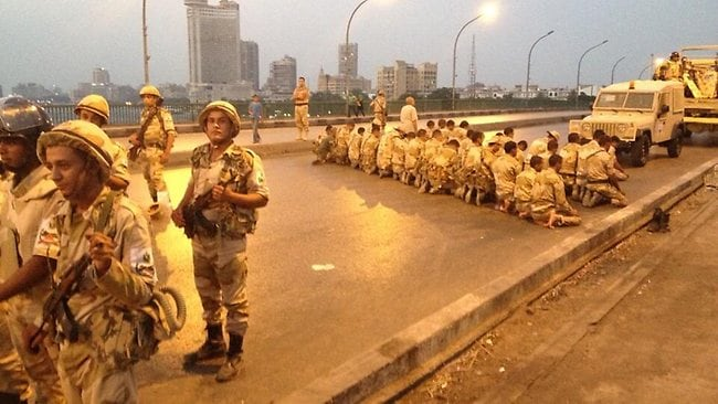 CNN correspondent Ivan Watson tweets a picture of Egyptian soldiers praying on the Jemaa bridge across the nile River at sunset in Cairo.