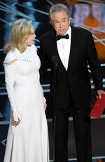 Faye Dunaway looks on as Warren Beatty speaks onstage during the 89th Annual Academy Awards on February 26, 2017 in Hollywood. Picture: Getty