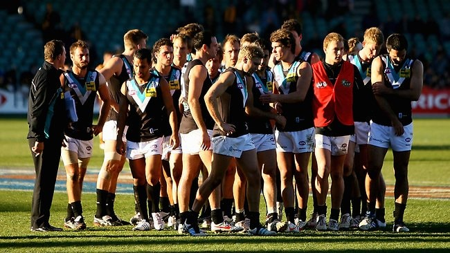 LAUNCESTON, AUSTRALIA - AUGUST 12: Port Adelaide players walk off the ground after the round 20 AFL match between the Hawthorn Hawks and the Port Adelaide Power at Aurora Stadium on August 12, 2012 in Launceston, Australia. (Photo by Robert Prezioso/Getty Images)