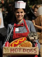 <p>Stacey Surman and Butter attend the 22nd Annual Tompkins Square Halloween Dog Parade: Picture: Timothy A. Clary/ AFP</p>  <br />