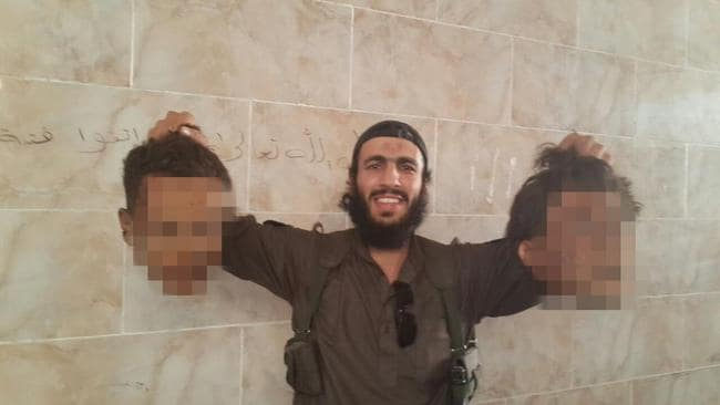 Mohamed Elomar, husband of Fatima Elomar, holding two severed heads in Syria where he was fighting for IS.
