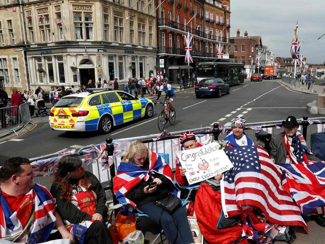 Royal fans have secured their viewing spots for the carriage procession. Picture: AFP