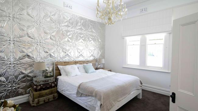 A bedroom makeover that recently appeared on House Rules is tasteful, but dark carpet and a shiny feature wall may not have broad appeal Supplied.