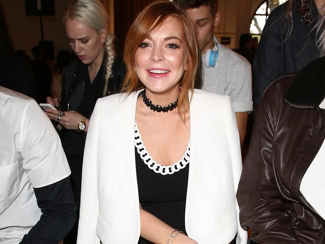 Supermodel enemy ... Lindsay Lohan attends the Moschino show in London. Picture: Getty