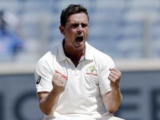 Australia's Steve O'Keefe celebrates the dismissal of India's Ajinkya Rahane on the second day of the first cricket test match between them, in Pune, India, Friday, Feb. 24, 2017. (AP Photo/Rajanish Kakade)